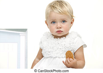 Boring looking baby with biscuit in hand