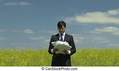 Boring paperwork - Bored businessman dealing shortly with...