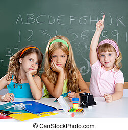 boring sad student with clever children girl raising hand ...