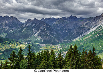 Bormio city and Dolomites top view, stormy clouds