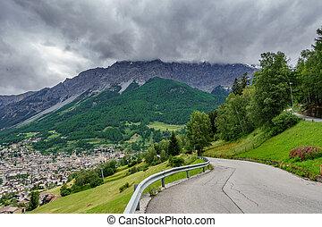 Bormio city, Dolomites, mountain road, storm is coming