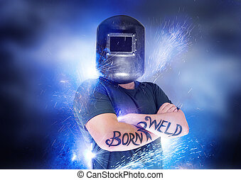 Born To Weld. Dramatic shot of a welder with blue sparks.