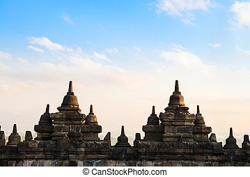 Borobudur Temple wall at sunrise. Indonesia.