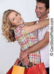borse, coppia, shopping, abbracciare, presa a terra