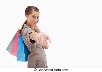 borse, shopping donna, indicare, sorridente, vista laterale