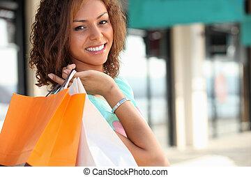 borse, shopping donna, metis, portante, sorridente