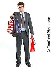 borse, shopping, stiramento, mano, completo, uomo