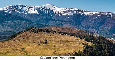 Borzhava mountain ridge with snowy tops. lovely nature...
