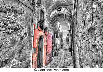 Bosa backstreet in selective desaturation - Picturesque ...