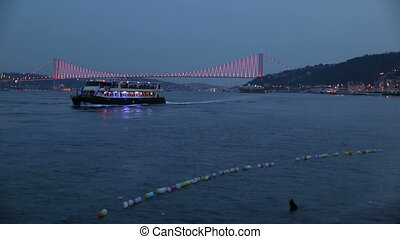 Bosporus Bridge - Bosphorus Bridge with passenger ship at...