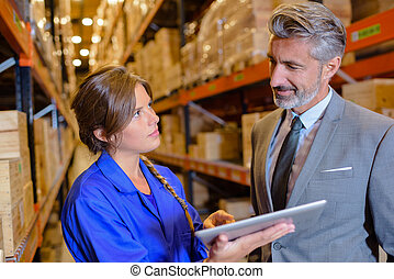 boss and employee in warehouse