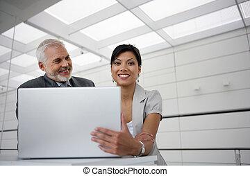 Boss and employee working in the corridor