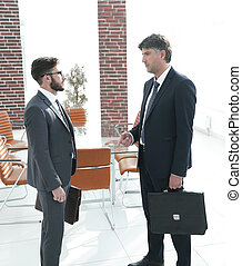 boss and the employee of the company are talking in the office