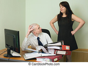 Boss and the secretary on a workplace