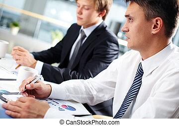 Boss at meeting