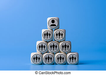 Boss concept with icons on wooden cubes, blue background.