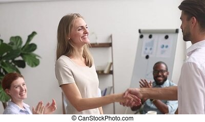 Boss congratulating female employee handshaking praising promoting happy woman worker