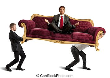 Boss doing yoga on sofa