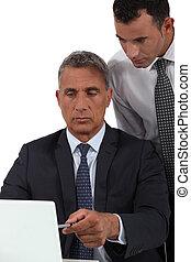 Boss explaining something to employee