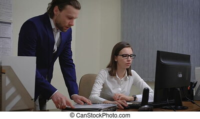 Boss gives a task to the Secretary girl. Senior business woman in a white blouse.