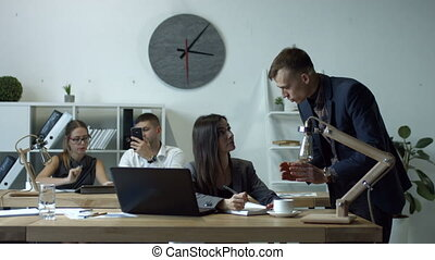 Boss giving orders and work task to female employee