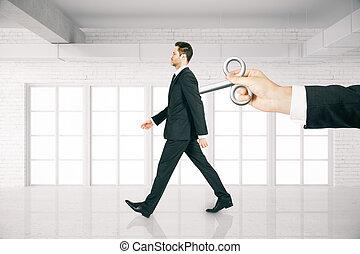 Boss hand controlling employee