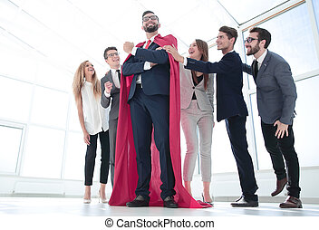 boss is a superhero and the business team is standing together