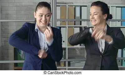 Boss Is Out - Close up of two business women performing...