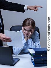 Boss making worker redundant - Vertical view of boss making...