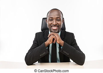 Boss - Businessman sitting with hands clasped and smile