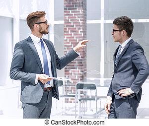 boss talking to an employee in the office