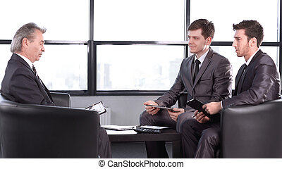 boss with a clipboard , sitting in an office. photo with copy space