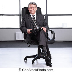 boss with a clipboard , sitting in an office