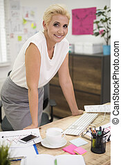 Boss working in her office interior