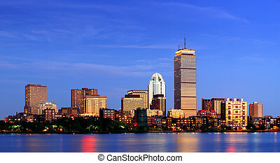 Boston city skyline at dusk with Prudential Tower and urban ...