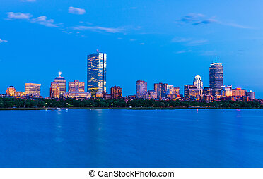 Boston cityscape. Panorama of Back Bay at dusk. View from Cambridge across The Charles River, Massachusetts, USA