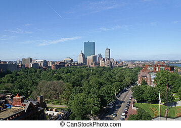 early morning in boston massachusetts on a lush spring morning, showing boston common and the back bay of copley square and the skyline beyond becon street