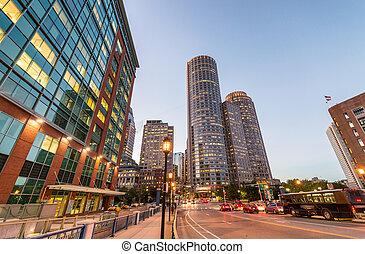 Boston night skyline. Lights of city buildings