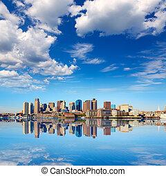 Boston skyline with river sunlight Massachusetts