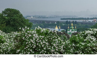 Timelapse of Kyiv botanical garden. View to the Vydubichi monastery and left bank of Dnipro river. Kyiv, Ukraine. Panning shot.