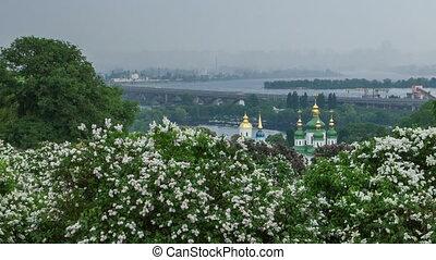 Timelapse of Kyiv botanical garden. View to the Vydubichi monastery and left bank of Dnipro river. Kyiv, Ukraine.