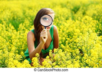 botanist woman in yellow flower field