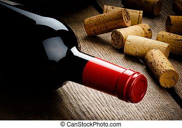 botella vino rojo, y, corchos