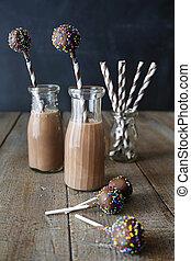 botellas, de, leche de chocolate, con, pastel, taponazos