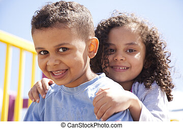 bother and sister hugging - mixed race brother and sister...