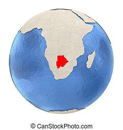 Botswana in red on full globe isolated on white