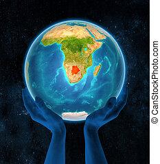 Botswana on Earth in hands