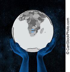 Botswana on globe in hands