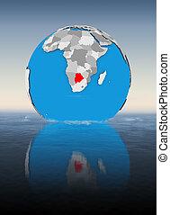Botswana on globe in water