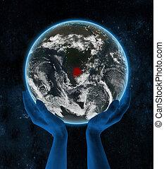 Botswana on night planet Earth in hands